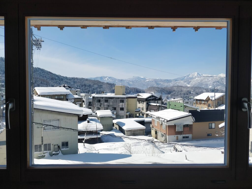 View from Tamanegi house (Nozawa) looking over the town and mountains.